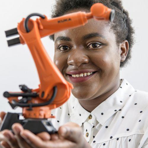 Audrey holding a robot