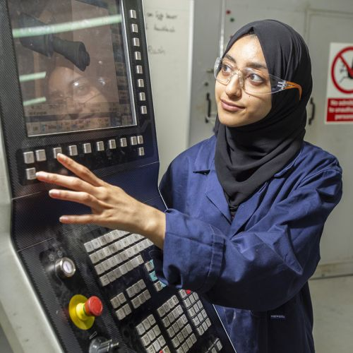 Ayesha using a machine