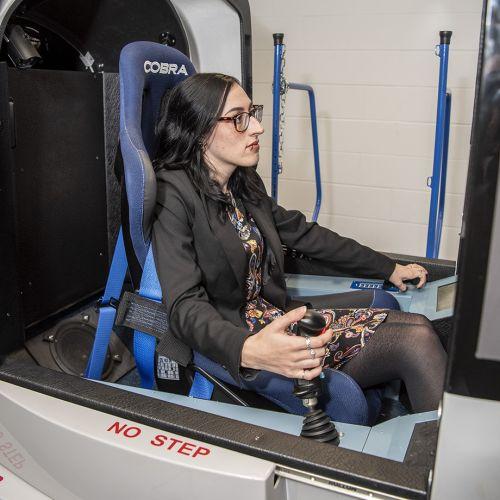 Sophie using the flight simulator